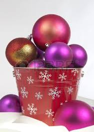 Red Gold And Purple Christmas Tree - bucket of red gold and purple christmas ornaments stock photo