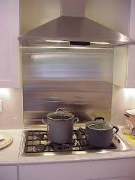 Stainless Behind Cooktop With Natural Stone Around It For The - Stainless steel backsplash lowes