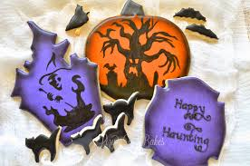 lizy b using pumpkin carving stencils as halloween cookie designs