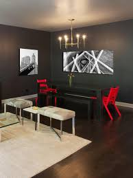 long white wooden table combined with black chairs on f the rug