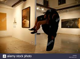 ilia yefimovich a israeli artist hanging upside down from