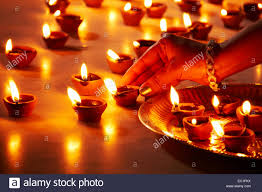 1 indian lady festival diwali home arranging diya worship stock