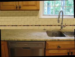 glass tile backsplash kitchen and grey subway with white cabinets