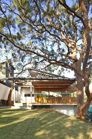 aussie escarpment house with angled roof and wavy ceiling