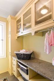 Laundry Room Cabinets With Hanging Rod The Lowly Laundry Gets Some Respect Laundry Rooms Laundry And Room