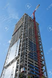 lifting crane at skyscraper construction site stock photo picture