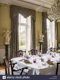 Grand Dining Room Georgian Style Dining Chairs In Grand Dining Room With Glass Stock