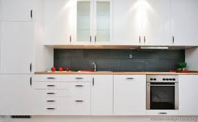 Modern White Kitchen Cabinets Redtinku - Contemporary white kitchen cabinets