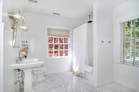 bathroom ideas with wainscoting traditional bathroom with wall sconce high ceiling in