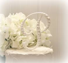 pearl cake topper 15 unique initial wedding cake toppers wedding idea