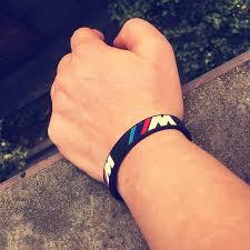 silicone wrist bracelet images 2pcs engrave hologram bracelets sport m power black white silicone jpg