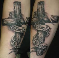 s wooden cross on forearm