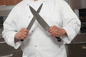 commercial kitchen knives chef sharpening knives in commercial kitchen stock photo image