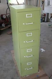 painting metal file cabinets how to paint a metal file cabinet stop me if you ve heard this
