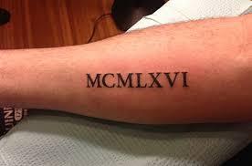 ancient numeral text on arm sleeve
