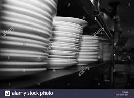 stacked plates on shelf in kitchen stock photo royalty free image