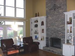 Stacked Stone Around Fireplace by Bookshelves Like These With Cabinets Under Them Would Be Perfect