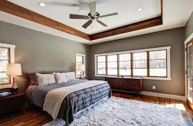light gray walls with wood trim bedroom contemporary with