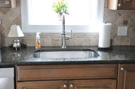 granite countertop white shaker kitchen cabinet doors glass tile