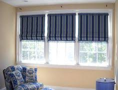 Printed Fabric Roman Shades - these functional roman shades have a 2 inch red banding around all