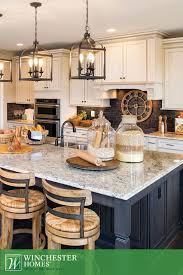 stone countertops lighting over kitchen island flooring backsplash