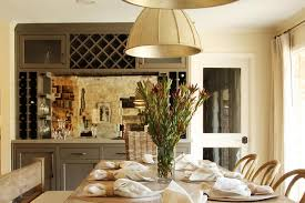 gray dining room bar with mirrored backsplash transitional