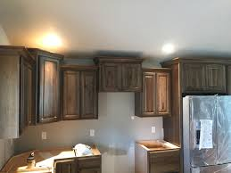 dark stain hickory cabinets with crown moulding kitchen remodels