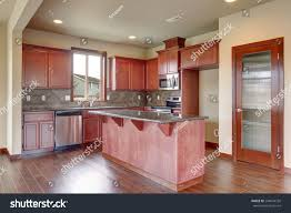 stained kitchen cabinets with hardwood floors traditional kitchen hardwood floor island stock photo
