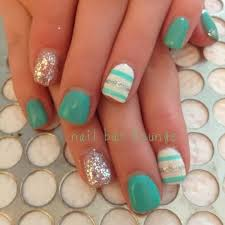 this cute nail design features an elegant stripe design on the