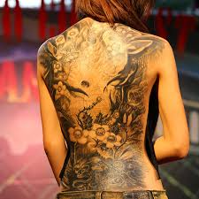 25 slick tattoo designs for women for 2013