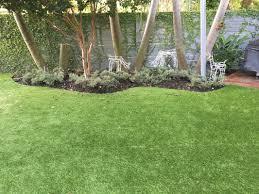 gallery image with breathtaking backyard turf installation