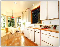 Yellow And White Kitchen Cabinets White Kitchen Cabinets With Stained Wood Trim Kitchen Counter