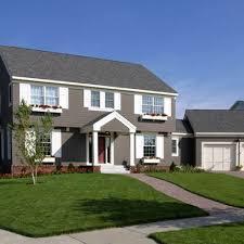 gray brick house split house color scheme brick grey white