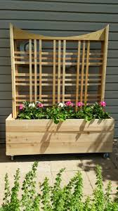 planter with trellis i made to cover up electrical box and meter