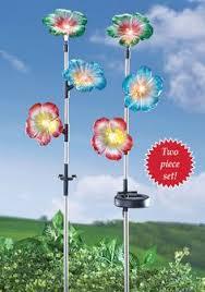 Solar Stake Garden Lights - solar light garden birds on telephone wire between poles yard