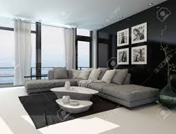 Floor To Ceiling Window Lounge Interior With A Dark Accent Wall And Floor To Ceiling
