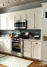 white kitchen cabinets counter tops blue gray backsplash of grey
