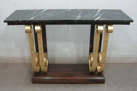 art deco console table with gold gild scroll legs timeless
