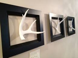 Christmas Decorations For Deer Mounts by Real Deer Antlers Painted And Hung On Wall With A Picture Frame
