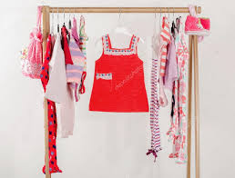 dressing closet with clothes arranged on hangers red wardrobe of