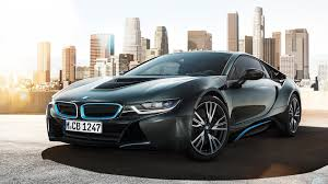 Bmw I8 Wrapped - first bmw i8 to be wrapped in the uk matte red carbon roof and