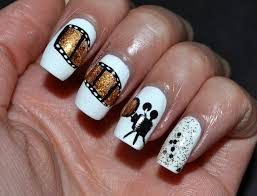 film strip nails ala zooey deschanel at the golden globes