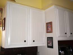 country kitchen refinished the doors with door casing and