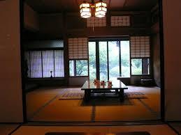japanese style living room furniture orange rug under wooden
