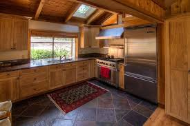 rustic kitchen with slate tile floors l shaped in valley