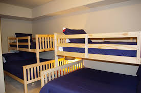 collins lake resort grand lodge north room with two bunk beds full size bottom bunks