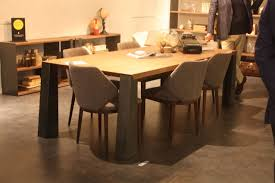 new dining room chairs offer style and comfort this dining set from maxdivani includes stylish wood and tweed dining chairs that are versatile enough