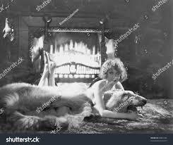 portrait woman on bear rug fireplace stock photo 95081332