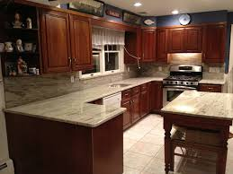 light cherry kitchen cabinets and granite soothing river white granite countertops