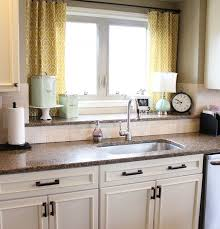 white kitchen curtains dark gray small square tile backsplash dark